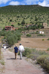 Ben Evans and Thomas Murray approaching the family home of rug designer and producer, Mustfa Hansali, Bin el Ouidane