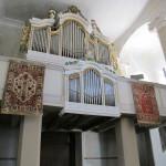 Rugs framing an organ