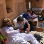 Guests plotting shopping routes around the souks from the terrace at Musee Boucharouite, Marrakesh