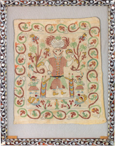 AN EMBROIDERED FIGURAL TEXTILE FRAGMENT