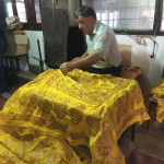 Wax resist dying of kalaghayi silk scarves, Baskal Silk Center