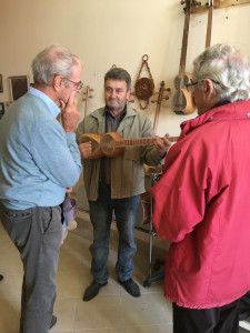 HALI Tour guests Daniel Chorzempa and Gerald Crowson are given a demonstration of local musical instruments, Sheki