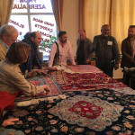 A discussion about silk rugs in a Sheki shop