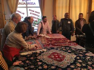 A discussion about silk rugs in a Sheki shop
