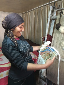 Terlan Mamedova inspects Vicki Fraser's work