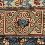 The Kufic main border appears in this form on many east Caucasian rugs of the 19th century, but has been found on just four rugs of the Boteh Khila group. The carnation design meander minor borders, with heavily corroded black dyes, show Turkish influence.