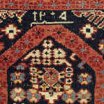The date inscription apparently reads 1205 AH (1794 CE) which seems too early, but could also be read as 1305 (1887). The innermost floral border surrounding the field, here on a red ground, seamlessly frames the niche. Similar floral borders are seen with Kufic borders on Konagkend rugs.