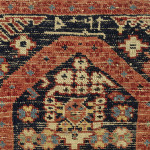 The back shows the slight warp depression, all-wool foundation and two wefts associated with such rugs. In this example there is no cotton in the foundation as is found in the larger workshop rugs of the region, which perhaps indicates that this rug was made at home and not in a workshop.