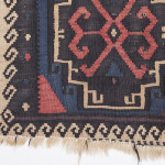 Tushetian kilim borders tend to be black and white with highlights of colour. While the ground of this piece employs a mostly naturally dyed coloured wool, the fluid Greek key border remains monotone.