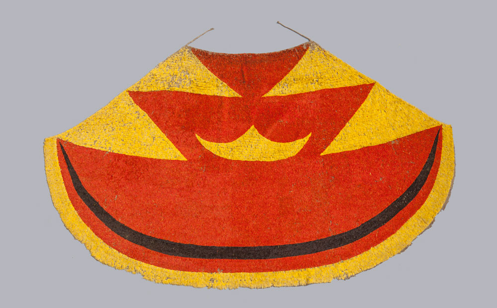 Ahu ula (feather cloak) belonging to Liholoho, Kamehameha II., Early 19th century Feathers, fibre, painted barkcloth (on reverse). 207 cm Museum of Archaeology and Anthropology, University of Cambridge