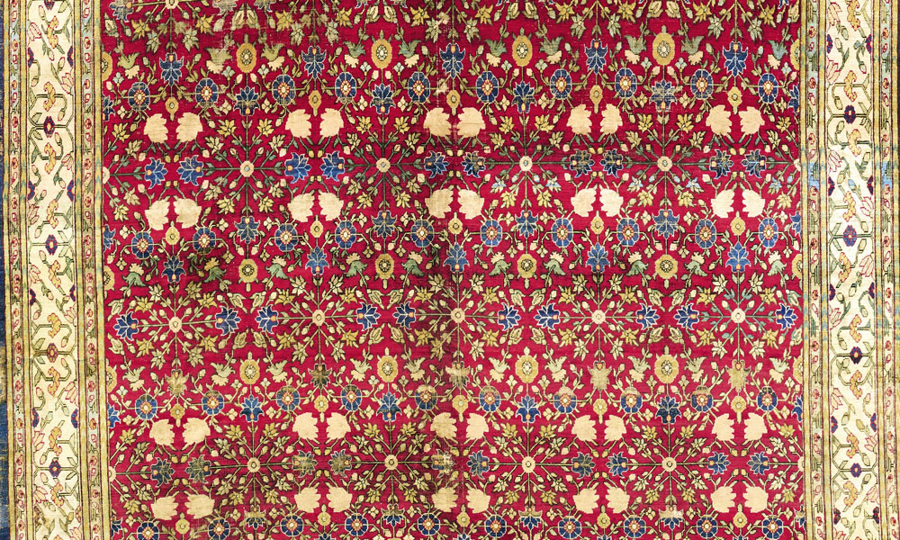 "Lot 52, Kashgar silk carpet, Xinjiang, late 17th/early 18th century. 2.17 x 3.61 m (7' 1"" x 11' 10""). Thyssen-Bornemisza collection, Sotheby's, London, 6 November 2018, estimate £80-120,000"