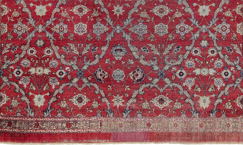 "Lot 46, Mughal silk floral lattice carpet fragment, Deccan, probably Hyderabad, late 17th century. 1.63 x 1.44m (5' 4"" x 4' 9""). Sotheby's, London, 6 November 2018, estimate £20-30,000"