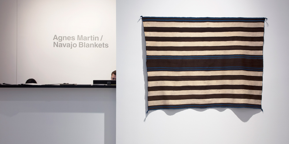 Installation view of the Cahn First Phase Chief's Blanket, Ute Style, Navajo, circa 1800- 1830. 'Agnes Martin / Navajo Blankets', Pace Gallery, New York