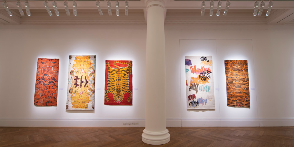Installation shot of 'Tomorrow's Tigers' art rugs on show alongside a selection of antique Tibetan Tiger Rugs at Sotheby's, London, 29 January – 4 February 2019.