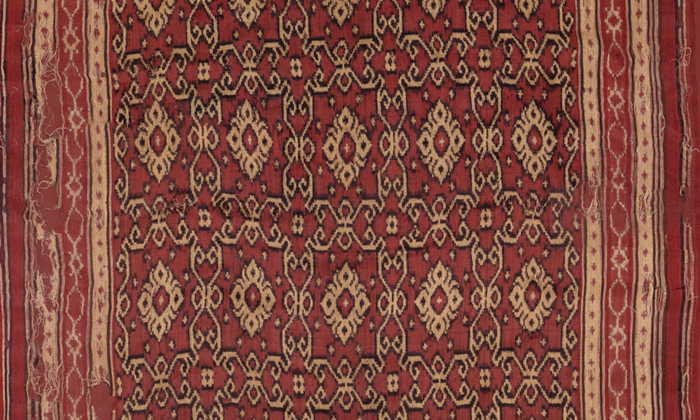 Patoluwith geometric design (detail), 18th century, India, Gujarat, made for the Indonesian market. Silk, double-ikat, resist-dyed, 2.21 x 0.89 m. Collection of Banoo and Jeevak Parpia.