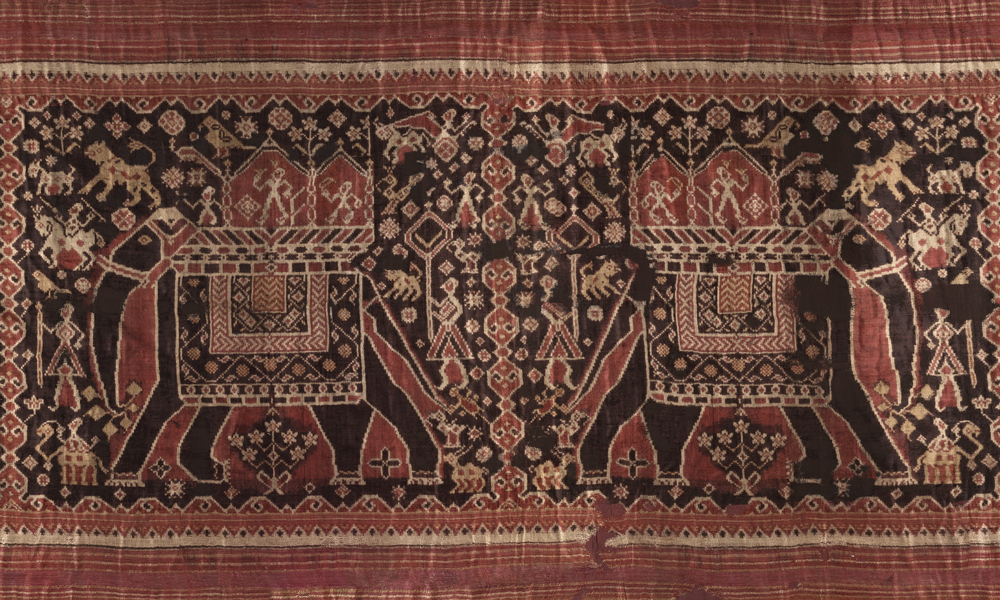 Patolu with design of four large elephants (detail), 19th century or earlier, India, Gujarat, made for the Indonesian market. Silk, double-ikat, resist-dyed, 1.02 x 3.95 m. Collection of Banoo and Jeevak Parpia.