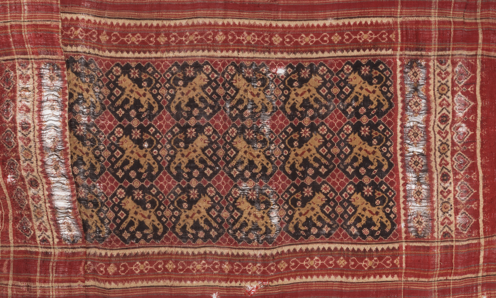 Patolu ceremonial cloth with design of tigers (detail), 19th century, India, Gujarat, made for the Indonesian market. Silk, double-ikat, resist-dyed, 0.78 x 1.47 m. Collection of Banoo and Jeevak Parpia.