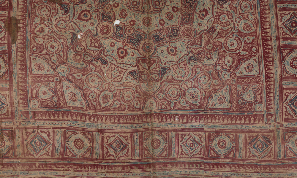 Half of a canopy or wrapping cloth (detail), 15th to 17th century, India, Deccan, made for the Indonesian market. Fine hand-spun cotton (plain weave), hand-painted mordant-dyed and resist-dyed, with hand-applied dye, 0.93 x 2.57 m. Collection of Banoo and Jeevak Parpia.