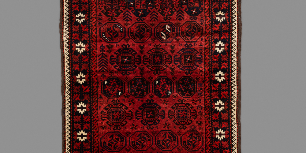 "Baluch dip-ghali rug (detail), Khorasan province,northeast Persia, early 20th century. Note the strong Turkmen design influence in the use of the kurbaghe gül. 0.94 x 1.72 m (3' 1"" x 5' 8"")"