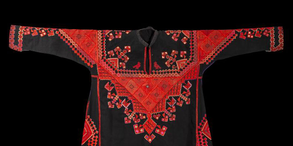 Front of a traditional woman's dress ('thōb) from Saraquib, Syria. Black cotton with hand embroidered decoration in silk. Donated by Jenny Balfour-Paul. Purchased by donor in Aleppo in 1985. ©Pitt Rivers Museum